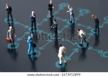 Social distancing, keep distance in public society people to protect COVID-19 coronavirus outbreak spreading concept, businessmen miniature keep distance away in the meeting with distant measure.