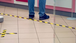 Social Distancing. Keep Your Distance. Marking on the floor of a pharmacy