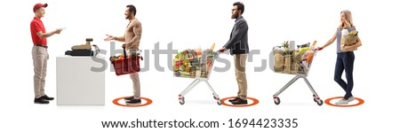Social distancing measures applied in a supermarket at a cash register for people waiting in line isolated on white background