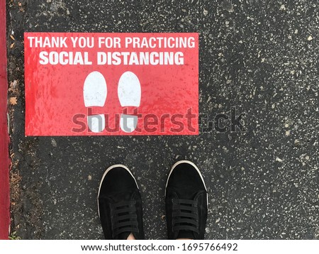 Social distancing sign for people line up in front of grocery store or retailer store  to reduce risk of crowded gathering in store during Covid-19 or Coronavirus crisis