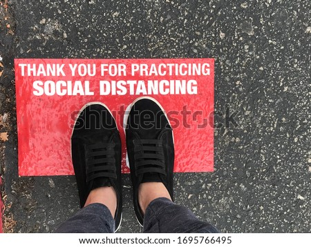 Social distancing sign for people line up in front of grocery store or retailer store  to reduce risk of crowded gathering in store during Covid-19 or Coronavirus crisis  Photo stock ©