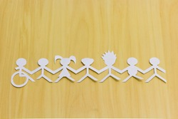 Social inclusion. Diversity and accessibility. Paper dolls illustrating different people united.
