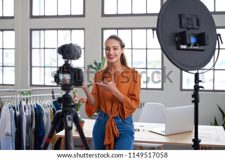 Social influencer creating online content for her channel, daily vlog Stock photo ©