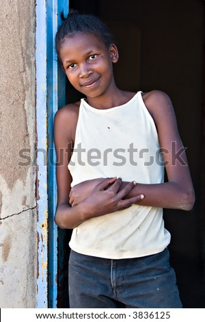 Social issues, poverty, African girl, underage farm worker, village near Kalahari desert