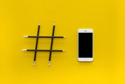 Social media and creativity concepts with Hashtag sign made of pencil and smartphone.digital marketing images.power of conversation.