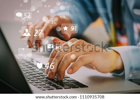 Social media and Marketing virtual icons screen concept.close up of businessman typing keyboard with laptop computer on wooden desk in modern office     #1110935708