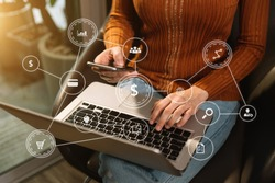 Social media and Marketing virtual icons screen concept.close up of businesswoman typing keyboard with laptop computer