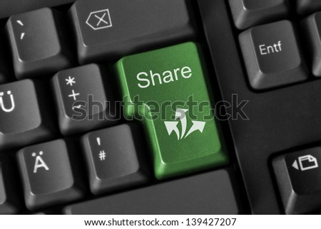 Social Media concept. Green computer Keyboard with sharing button.