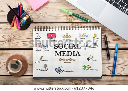 Social Media Concept On Work Desk With Various Hand Drawn Doodle Icons On Paper #612377846