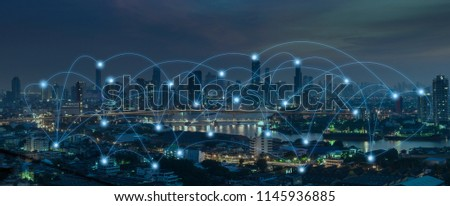 Social media connection by wireless telecommunication technology with cityscape background #1145936885