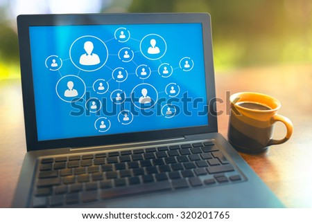 Social media connection concept laptop on table with a coffee cup