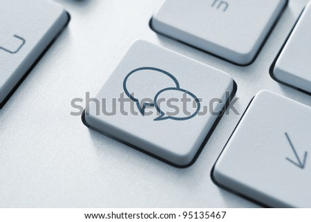 Social media key with two speech bubble sign on the keyboard. Toned Image.