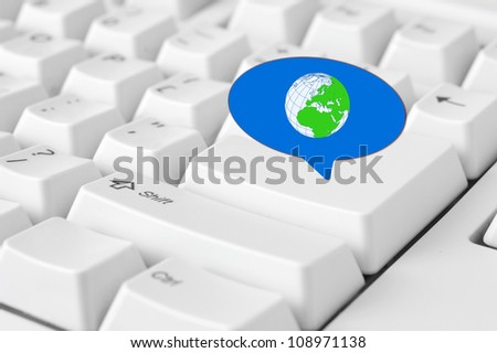 Social media key with world symbol in speech bubble sign on the keyboard