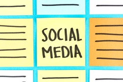 Social media marketing. Advertising banner concept with grid paper notes on blue background.