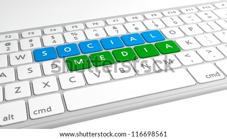 Social Media on a keyboard, with blue and green.