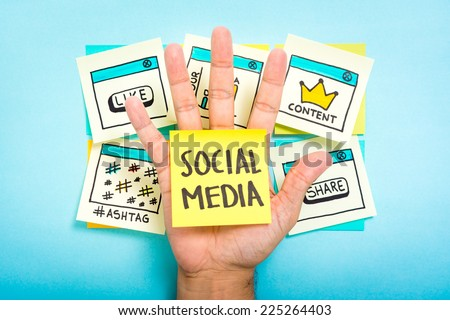 Social media on hand with blue background. Content marketing. #225264403