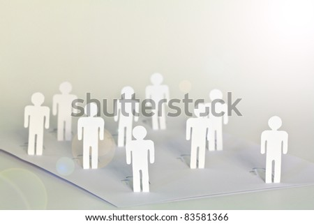 Social Network concept : close up of people cut out of paper on white background