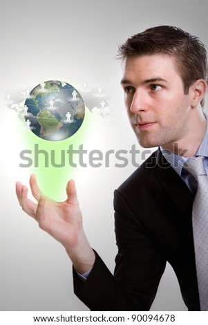Social Network concept :young business man holding earth of social network