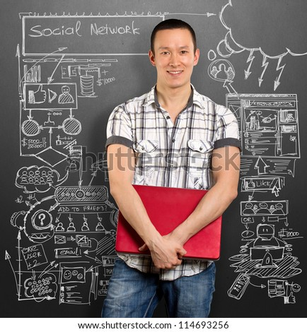 Social network idea concept, man with laptop in his hands, looking on camera