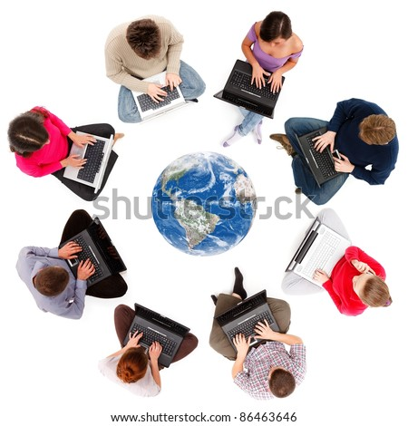Social network members typing on laptop computers, seen from above