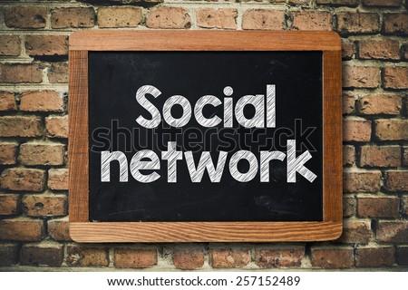 Social network on Blackboard. Social network on Blackboard on bricks wall