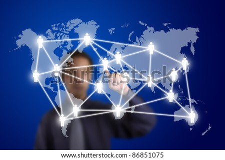 social network or business connection with world map on touch screen pointed by a man - stock photo