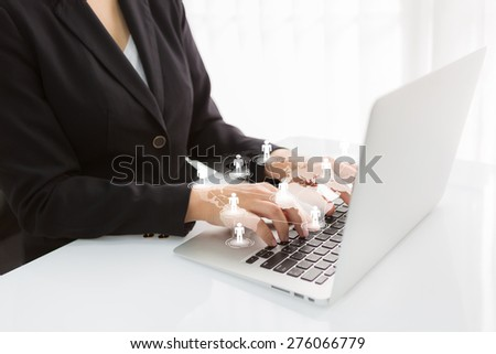 Social networking concept : Business woman hand typing on Laptop with social network on world map