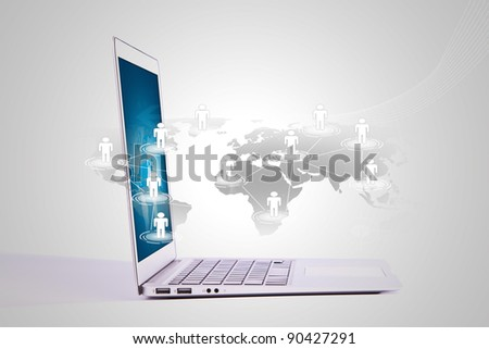 Social networking concept : Laptop with social network on world map