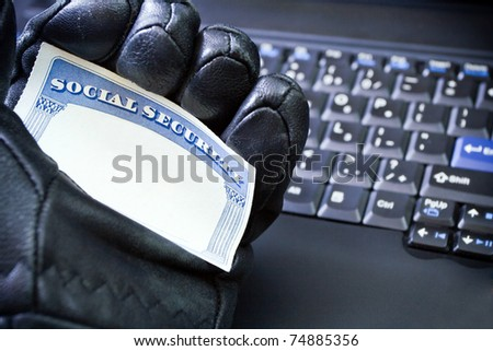 Social Security Card in hacker's hand, internet and identity theft