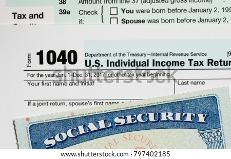 Social Security card in the USA laid on top of Form 1040 tax return of income in retirement #797402185