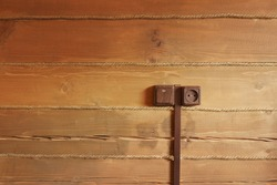 socket and switch on the wooden wall