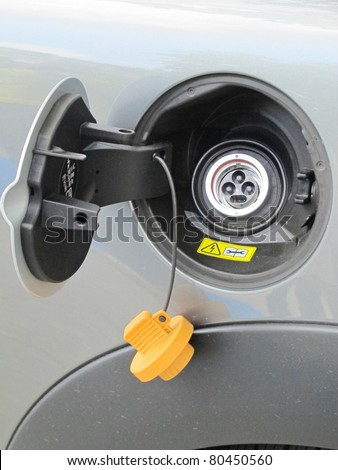 socket of an electric car ready for charging