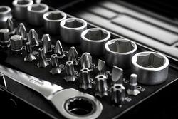 Socket set, Metal bits for socket wrench on black background
