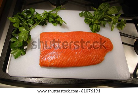 Sockeye salmon fillet, with parsley and basil - stock photo