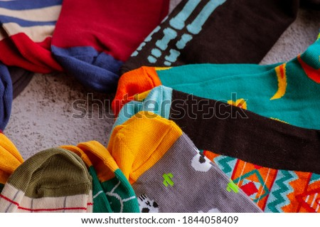 Socks colorful. Set of socks. Colorful socks. Knitted socks on a gray background