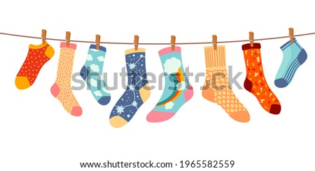 Socks on rope. Cotton or wool sock dry and hang on laundry string with clothespins. Children socks with textures and patterns  cartoon. Illustration wool and cotton socks in rope