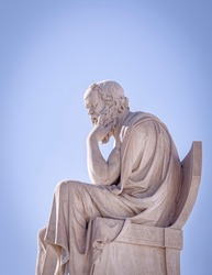 Socrates the ancient Greek philosopher and thinker white marble statue under blue sky, Athens Greece