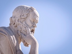 Socrates the ancient Greek philosopher and thinker white marble statue under blue sky, space for your text