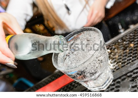 soda being poured into glass
