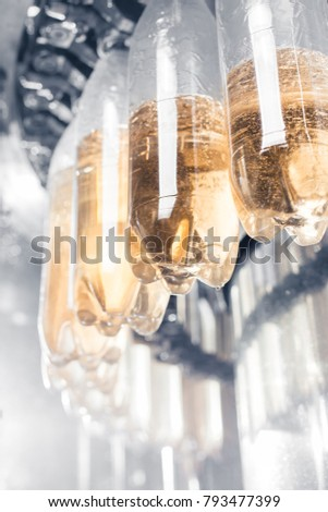 Soda bottles in the production process. #793477399