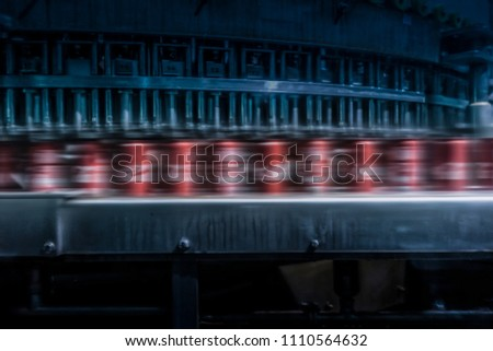 soda cans to pass with speed on the factory line. #1110564632