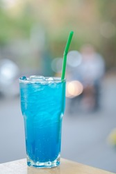 soda water with blue syrup in a glass