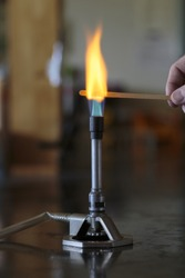 Sodium solution burning on a wooden splint in a bunsen burner flame.