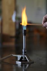 Sodium solution burning on a wooden splint in a bunsen burner flame.