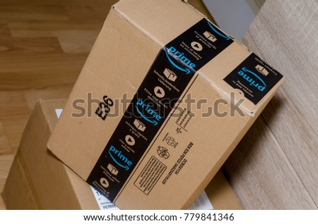 Soest, Germany - December 19, 2017: Amazon Prime logotype printed on cardboard box security scotch tape. Amazon Prime is a paid subscription service offered by Amazon.com. Illustrative editorial.