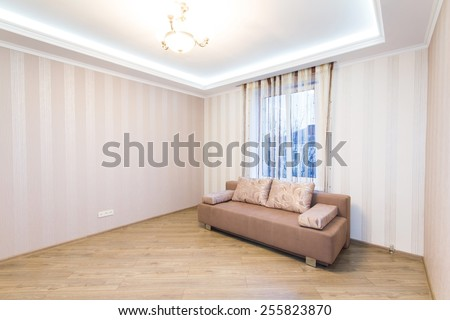 Sofa in the interior, a large spacious room.. Modern interior room with nice furniture inside