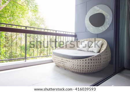 Sofa on the balcony with garden view. #416039593