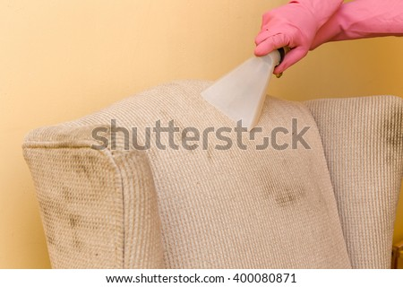 Sofa or armchair chemical cleaning with professionally extraction method. Dirty upholstered furniture. Early spring cleaning or regular clean up.