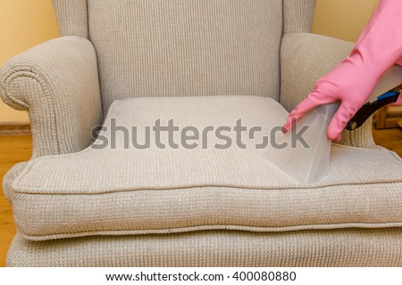Sofa or armchair chemical cleaning with professionally extraction method. Early spring cleaning or regular clean up.
