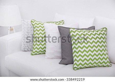 Sofa with colorful pillows in room #338492219